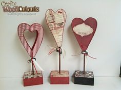 3 Hearts on Dowels. The middle one is about 3.5″ wide and 14″ tall and the set of 3 costs $15.99.
