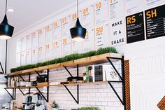 well i know this is a juice bar but i DO just love the row of (presumably wheat) grass along the top! would look fab any kitchen.