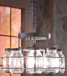 Add country charm to any room with this rustic Wrought Iron Canning Jar Chandelier. You can order it with the glass jars included or use your own jars. The heavy-gauge, durable iron frame is designed to hold 8 canning jars around the outer edge. The chan