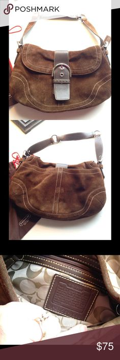 "Brown Suede Coach Bag Beautiful suede, with cream top stitching, buckle with magnetic closure, large pockets across the back with magnetic closure!  Two compartments inside the bag, 1 large compartment,  another the same size, with zipper pocket on one wall, & 2 cell or sunglasses pockets on the other side! Measures 13"" across, 8"" tall, adjustable shoulder strap! Coach signature lining! Coach Bags Shoulder Bags"