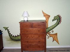 Love the dragon peeking out from behind the dresser.