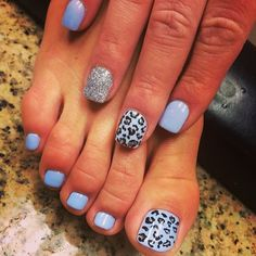 Love the blue color.  I think if I were doing a guy's nails, I'd skip the spots, just do the blue on toes and fingers, with only blue and then the glitter accent nail on fingernails.