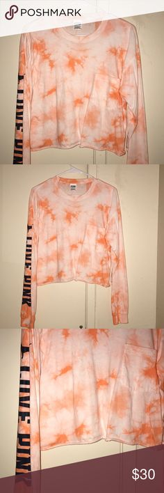 Tie Dye Orange Campus Tee! 🍊🎉 Victoria's Secret Pink long sleeve cropped campus tee, size extra small.  Washed but never worn, no imperfections.  Feel free to ask questions!  Great for night time in Spring break or as a swimwear cover up.  I bought this in November 2017 at full price but couldn't find the photo online.  Tags:  orange coral white cream ivory campus tee pocket black dog logo love pink university collegiate college spring break sweatshirt crew crewneck pullover cover up tye…