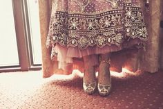 indian-wedding-bride-red-lengha-gold-heels-silver-embroidery by Fotolicious