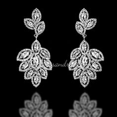 A radiant design of two clusters of marquise CZ jewels surrounded by smaller round cubic zirconia. The wedding earrings are very detailed! They are about 1 and