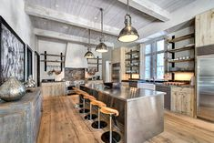 Stainless steel and natural wood create the perfect industrial space.
