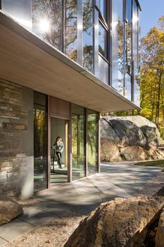 This house in the woods has a mirrored facade which reflects the natural landscape