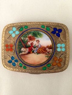 EXCEPTIONAL ENAMEL & SILVER COMPACT WITH EXQUISITE FLOWERS SURROUNDING A COUPLE