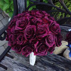 Burgundy silk roses.