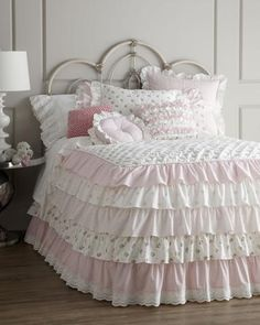 I want to sew ruffles onto Alana's crib comforter when she trasitions to a big girl bed. I could so do this.  Pink ruffle bed linens.     OMG..  How would you say it???  STINKIN CUTE.... Yes, You can do it!!