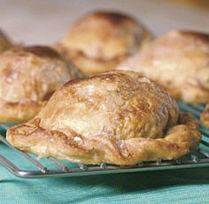 Apple turnovers When the first few nights turn chilly, all thoughts go to baking—and apples. These turnovers are a classic guaranteed to fill your kitchen with the homey smells of fall. You also use this wonderful, … Apple Turnover Recipe, Apple Turnovers, Just Desserts, Delicious Desserts, Yummy Food, Tasty, A Food, Food And Drink, Apple Recipes