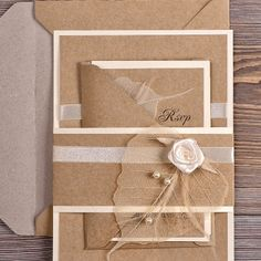 wedding invitation set ... kraft with white ... sparkly organdy ribbon wrap .. skeleton leaves ... pearls ... rolled satin ribbon rose ....