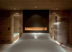 Chalet Gstaad is a private holiday chalet in the Swiss Alps, designed by Laurence Rouveure of Ardesia Design in collaboration with Amaldi Neder Architects