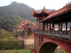 Asian architecture - interesting carved dragons at bottom of bridge