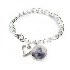Made this bracelet to remembered Harambe.  #harambe #harambee #gorilla #gorillabracelet #charmbracelet #animallovers  #handmadebracelet #animalbracelet #jewelrylized #handmadewithlove #picturebracelet #petbracelet #photobracelet #braceletforsale #giftforfriend #giftforher #giftforanimallover #memorialbracelet #bracelet