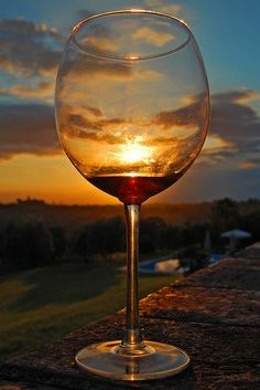 I love this shot - It was the last night in Montespertoli, in our gorgeous villa, and the sunset was magnificent... I couldn't resist taking this shot through someone's Red Wine Glass. great wine glass gifts