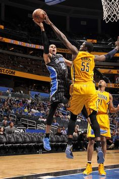 Roy Hibbert blocks the shot of the Orlando Magic's Tobias Harris in the Pacers' 115-86 victory on March 8, 2013