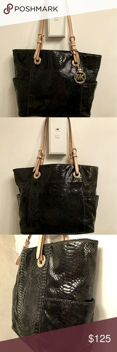 """MICHAEL Michael Kors jet set python leather bag Black python-embossed leather tote bag w/tan dual adjustable shoulder straps.Buckled top handles loop through logo-engraved grommets.Goldtone MK hardware. Sturdy hanging logo fob & 'feet'. Light scratches.Open bag w/interior zip pocket, cell phone pocket etc, 2 exterior side pockets.Logo MK black fabric interior w/factory tag sewn into lining.11""""height x 16"""" across (top laid flat) / 12"""" across (bottom) x 6""""width (bottom).Beautiful bag, like…"""
