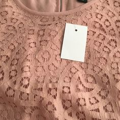Jcrew pink shirt NWT Size 14 Light pink lace shirt with underlay. Bottom is scalloped. Key hole back. I feel this was generously sized as 14. J. Crew Tops Blouses