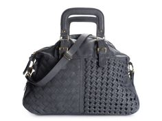 I need this purse. Now I just need the extra money to buy it.
