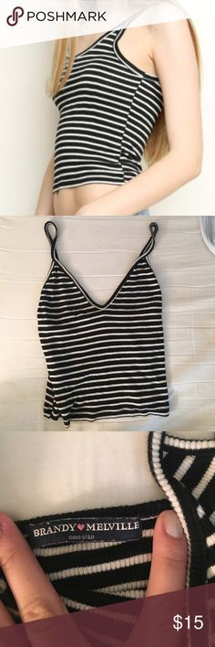 Brandy Melville Striped Tank Super cute and flattering V neck cropped tank from Brandy! (I know what you're thinking– do we sell anything OTHER than Brandy?? 😂😂) This tank is in perfect condition! Make offers! Brandy Melville Tops Crop Tops