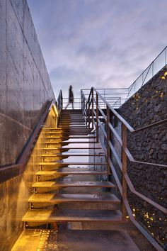 Platform_a completes reflective glass and volcanic stone cafe on Jeju island coast
