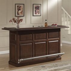 American Heritage Billiards 600044NAV-S Catania Home Bar This Home Bar by American Heritage Billiards comes in a navajo finish.  Catania Home Bar	Brushed