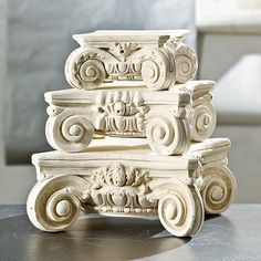 BALLARD DESIGNS: The elaborately scrolled design for this decorative pedestal is based on a classical Ionic column developed by the Greeks and later adopted by the Romans and much of the ancient world. Use our Greco-Roman pedestal to display found objects, plants or pile it high with books. Medici Capital features: Stack a small & large to create a small side table Hand cast Museum white finish.