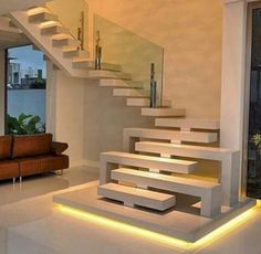 For the interior, the architect tries to create a simple design with a natural atmosphere as much as possible. The wall, stairs, and ceiling are white and decorated with some simple details such as fr Staircase Interior Design, Home Stairs Design, Modern House Design, Home Interior Design, Exterior Design, Interior And Exterior, Interior Ideas, Contemporary Stairs, Modern Stairs