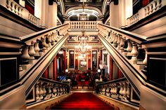 Lobby and Staircase at Saint James Hotel Paris: The soaring walls and cornices are painted in black and white, creating a graphic space. Paris Hotels, Hotel Paris, Paris France, Oh Paris, France Cafe, Paris City, France 1, Hotels And Resorts, Best Hotels