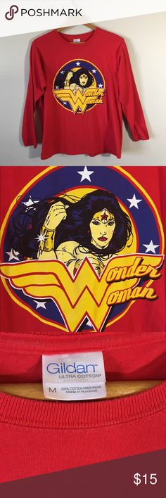 Wonder Woman Tee Love Wonder Woman? Then this shirt is for you! Long sleeve and perfect for fall ❤️ The brand of shirt is Gildan so it's super soft cotton. Size M. Same/next day shipping. All bundles 30% off. Gildan Tops Tees - Long Sleeve