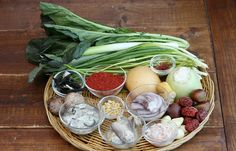 The ingredients for <i>bossam kimchi</i> include salted cabbage, radish, chili peppers, chestnuts, pine nuts, jujubes, baby octopus, oysters and mushrooms.