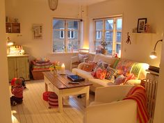 white floors / white sofa / colorful pillows...maybe when the kids move out! No white for now