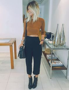 Black culottes with black ankle boots and long sleeved top