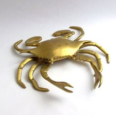 Heavy brass articulate crab ashtray with a hinged lid. Measures approximately 8 inches across 7 1/2 inches long. Perfect gift for that Cancer in