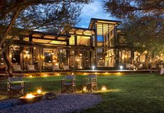 Game Lodge in Thabazimbi / Marataba Safari Lodge is a simple extension of the natural environment beyond its walls – rich, bold, organic and patently . Glass House Garden, Luxury Lodges, Farm Cafe, Thatched Roof, Beautiful Places To Travel, Beer Garden, Roof Design, Log Homes, Modern House Design