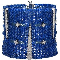 Preowned Distinctive Ceylon Sapphire Bead Bracelet ($26,800) ❤ liked on Polyvore featuring jewelry, bracelets, blue, cuff bracelet, blue sapphire jewelry, 18k jewelry, hinged cuff bracelet and beaded jewelry