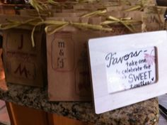 My design for rustic bridal shower wedding favors. Hand stamped and tied, filled with homemade treats.