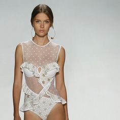 Swim Detail: Dot, mesh and embroidery.  We're flashing back to our Spring 15 collection show in September, and our Tarot contour flounce 1pce is now instore. #spring15 #tellmeseer #tarot #swim #nyfwzimmermann
