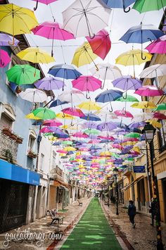 "Águeda: Umbrella Sky Project 2014 - via Gail Aguiar Image Legacy  21.07.2014 | he Umbrella Sky Project — ""add colour to your life!"" — is an annual art installation around the municipality of Águeda in the Aveiro district of Portugal. This is the third year for the floating umbrellas, as part of the ninth year of AgitÁgueda, a July festival promoting local culture and the arts in the region. Photo: Umbrella Sky Project 2014 (Águeda, Portugal) (10)"