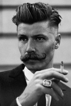Slicked Back Hair | Handlebar Mustache | Smoking Man | Statement Ring (Francois Verkerk)  Dandy moustache, my good sir!