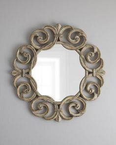 <3 Intertwining Scroll reminds me of sea waves ~ Accent Mirror at Horchow.