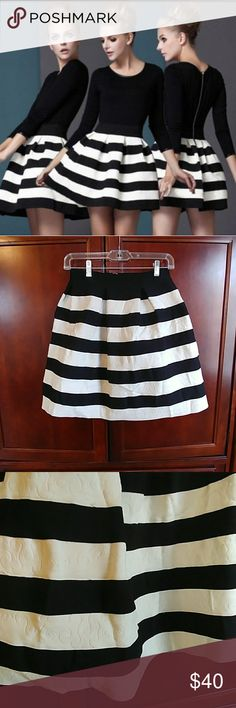 Flare striped black and white skirt Perfect staple for any closet! Very thick heavy great quality! Waist has alot of stretch. Tiny stain that can probably be removed. Not very noticeable. Skirts A-Line or Full