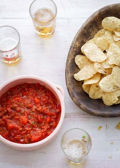 Nigella Lawson: Simple, Spiky Salsa and a bowlful of tortilla chips. Simply Nigella, Blue Corn Chips, Sauces, Homemade Tortilla Chips, Tinned Tomatoes, Nigella Lawson, Mini Hamburgers, Recipe Of The Day, Other Recipes