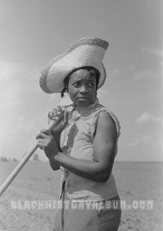 Field of Dreams - African American migrant worker hoeing cotton, 1938.