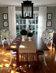 Love this dining room, the black & white fabric on the chairs, the white curtains, the wall color and lantern
