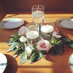 floating candles with greenery ring and roses