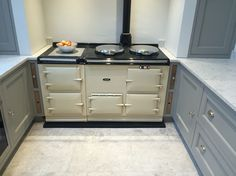 Cream AGA with Grey marble floor and oak insert chopping boards / trays Aga Kitchen, Bakery Kitchen, Kitchen Living, Kitchen Appliances, Kitchen Ideas, Cream Aga, Chopping Boards, Marble Floor, Kitchen Interior