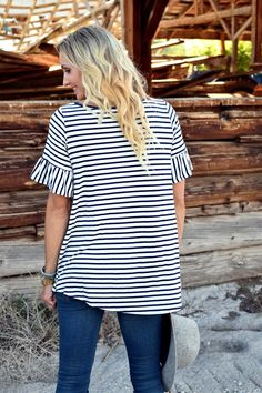 This is our new go-to tunic! This versatile piece is a must-have for every woman's wardrobe! The classic bell sleeves are feminine and on-trend for 2017.