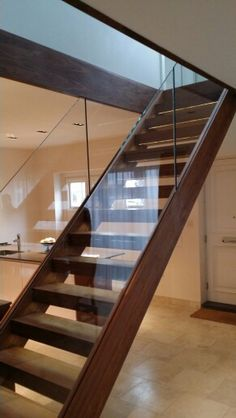 Walnut stairs and frameless glass balustrade. Treads including led lights.